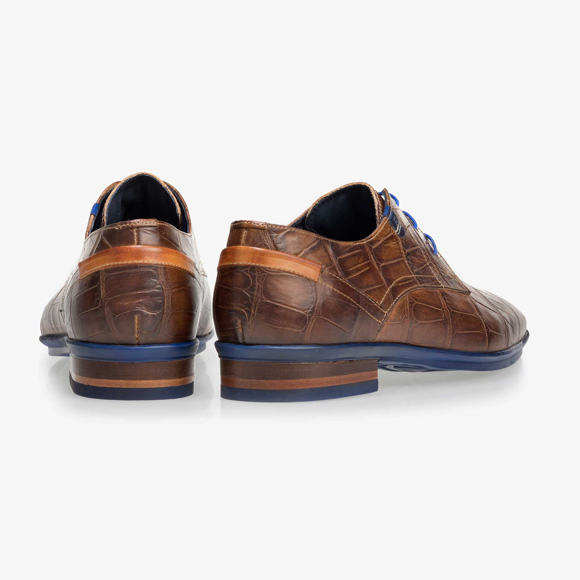 Brown leather lace shoe with a croco print