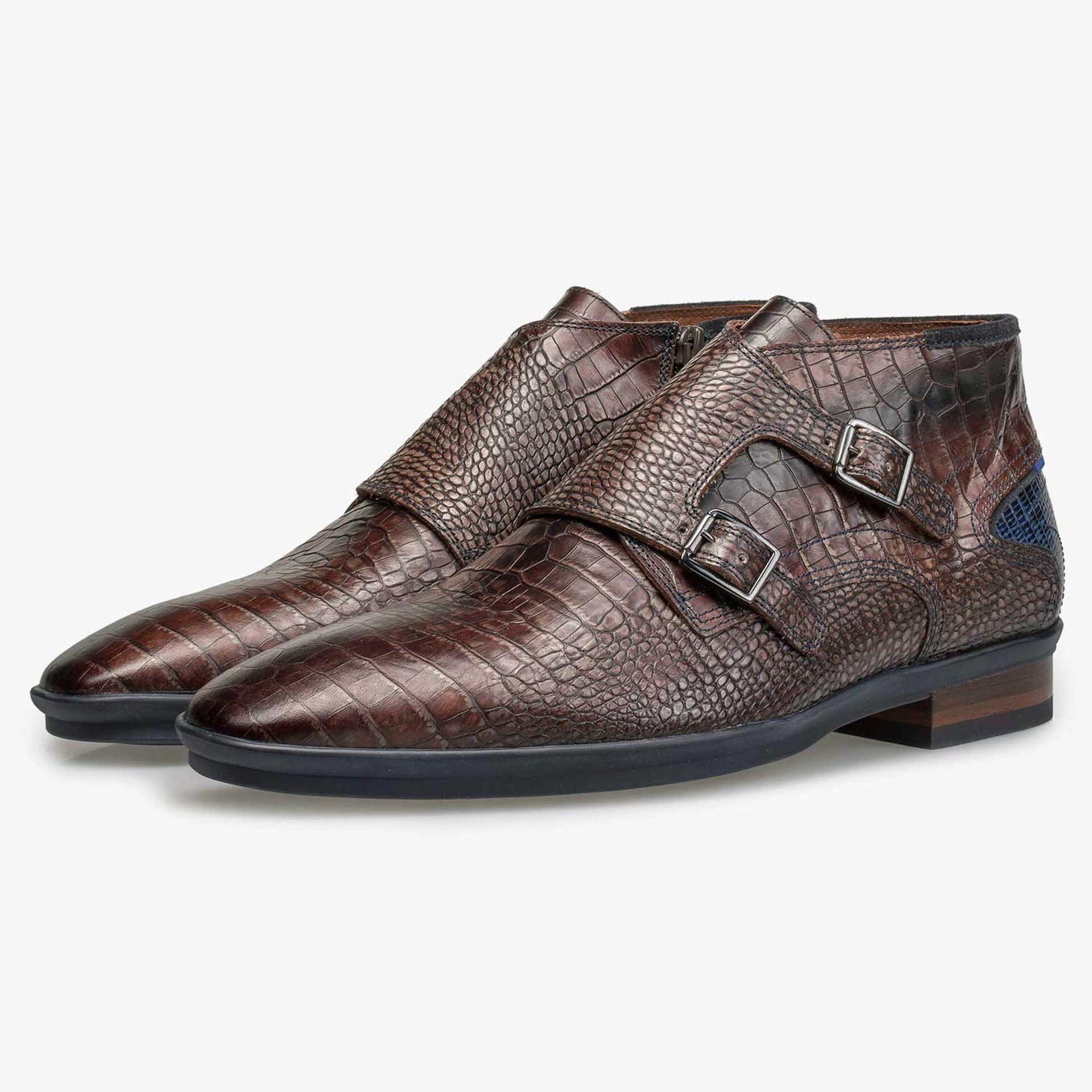 Dark brown buckled shoe with croco print