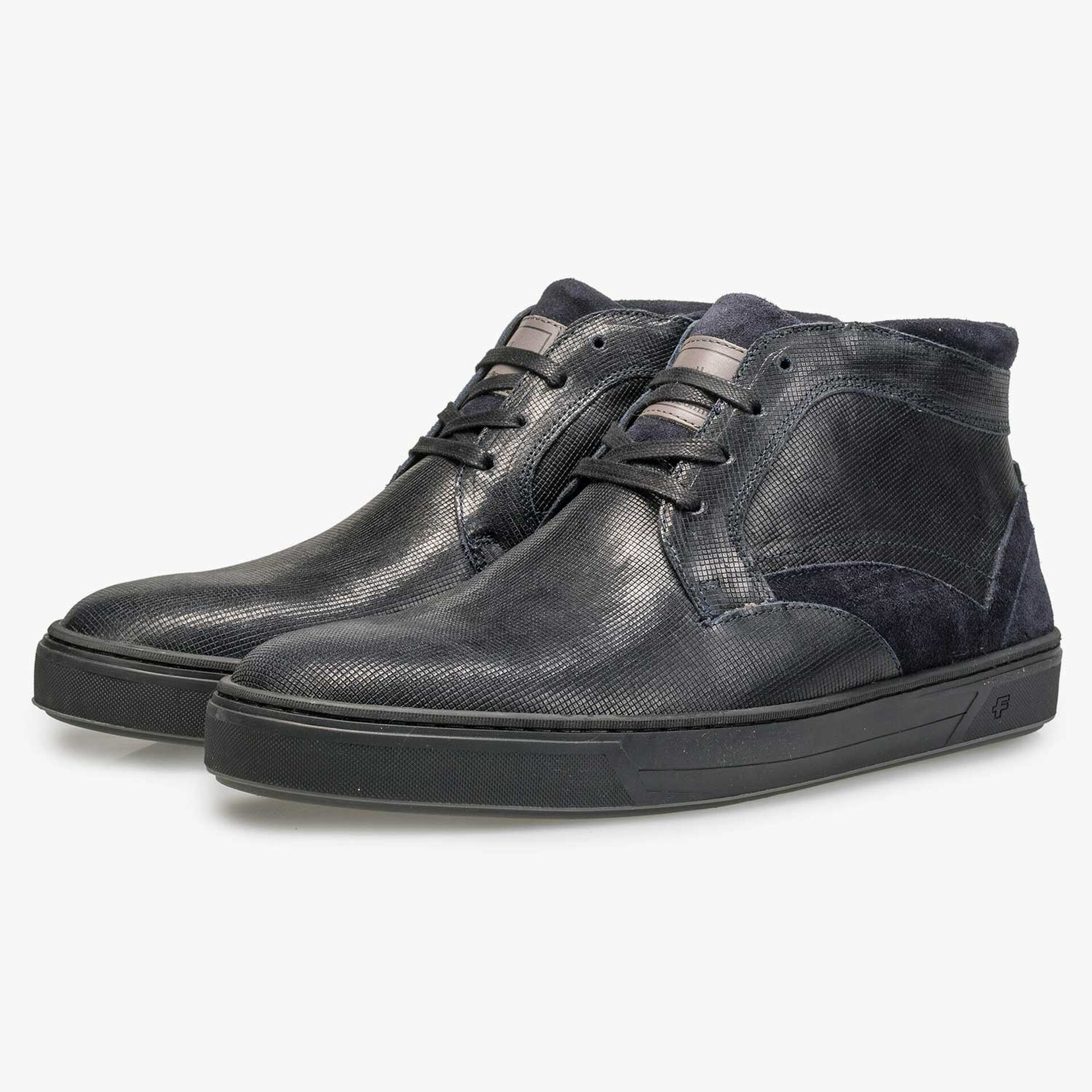 Wool lined, mid-high calf's leather shoe