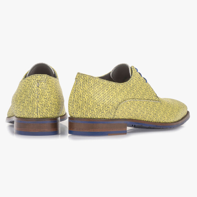 Yellow leather lace shoe with black print