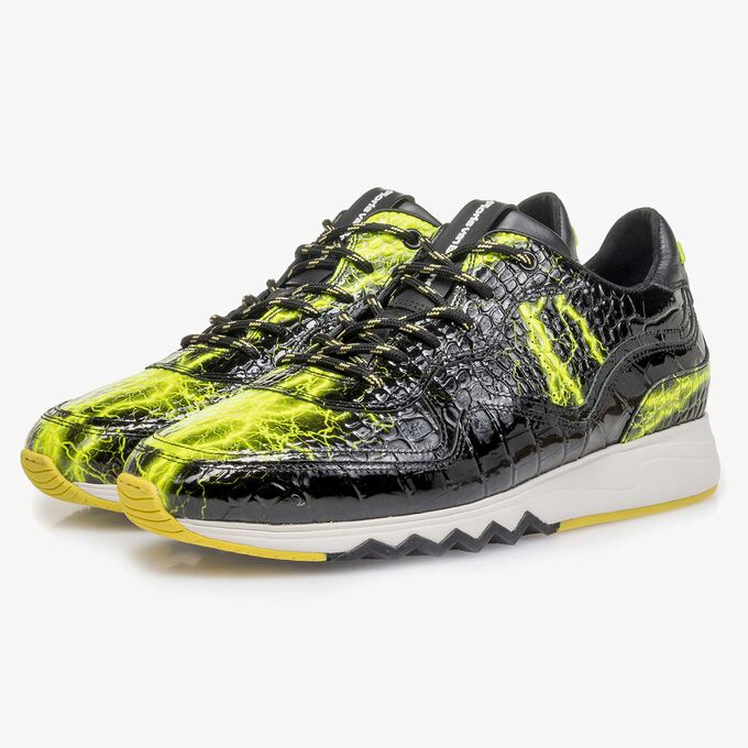 Black patent leather sneaker with yellow print