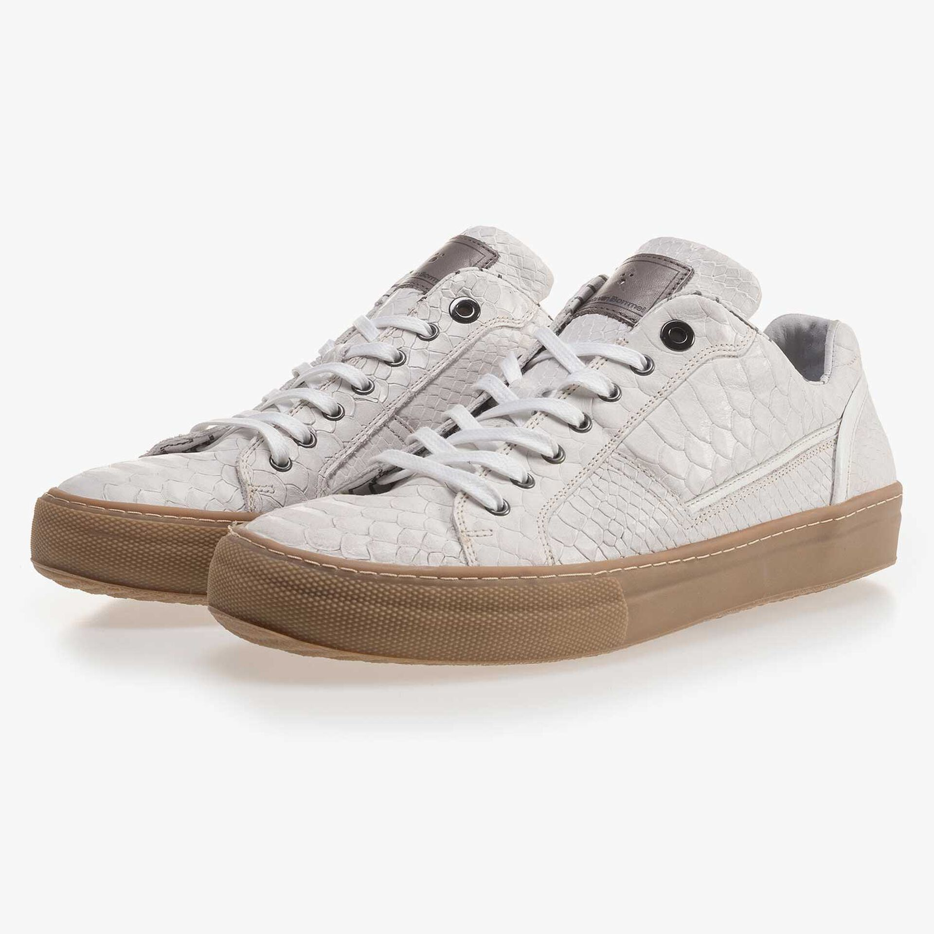 White leather sneaker with a snake print