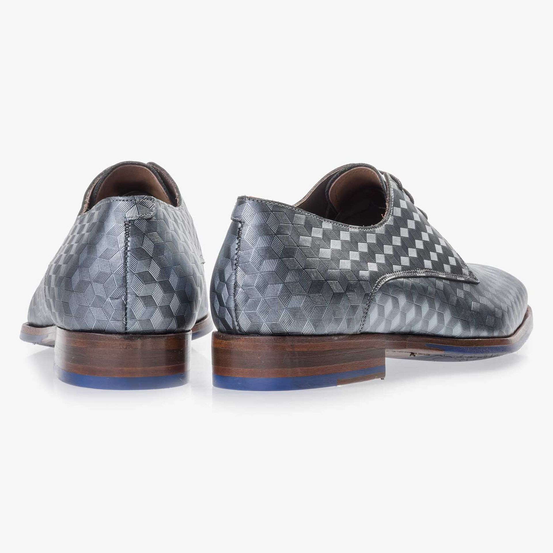 Grey leather lace shoe finished with a hexagon print