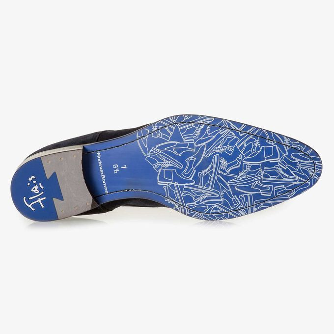 Dark blue suede leather lace shoe with a laser-cut pattern