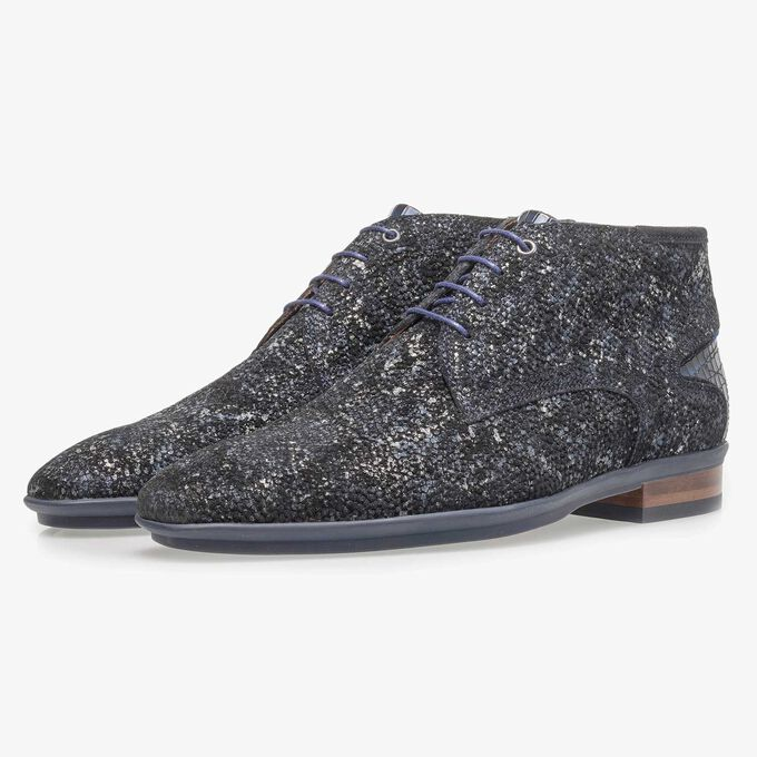 Dark blue leather lace shoe with an organic texture