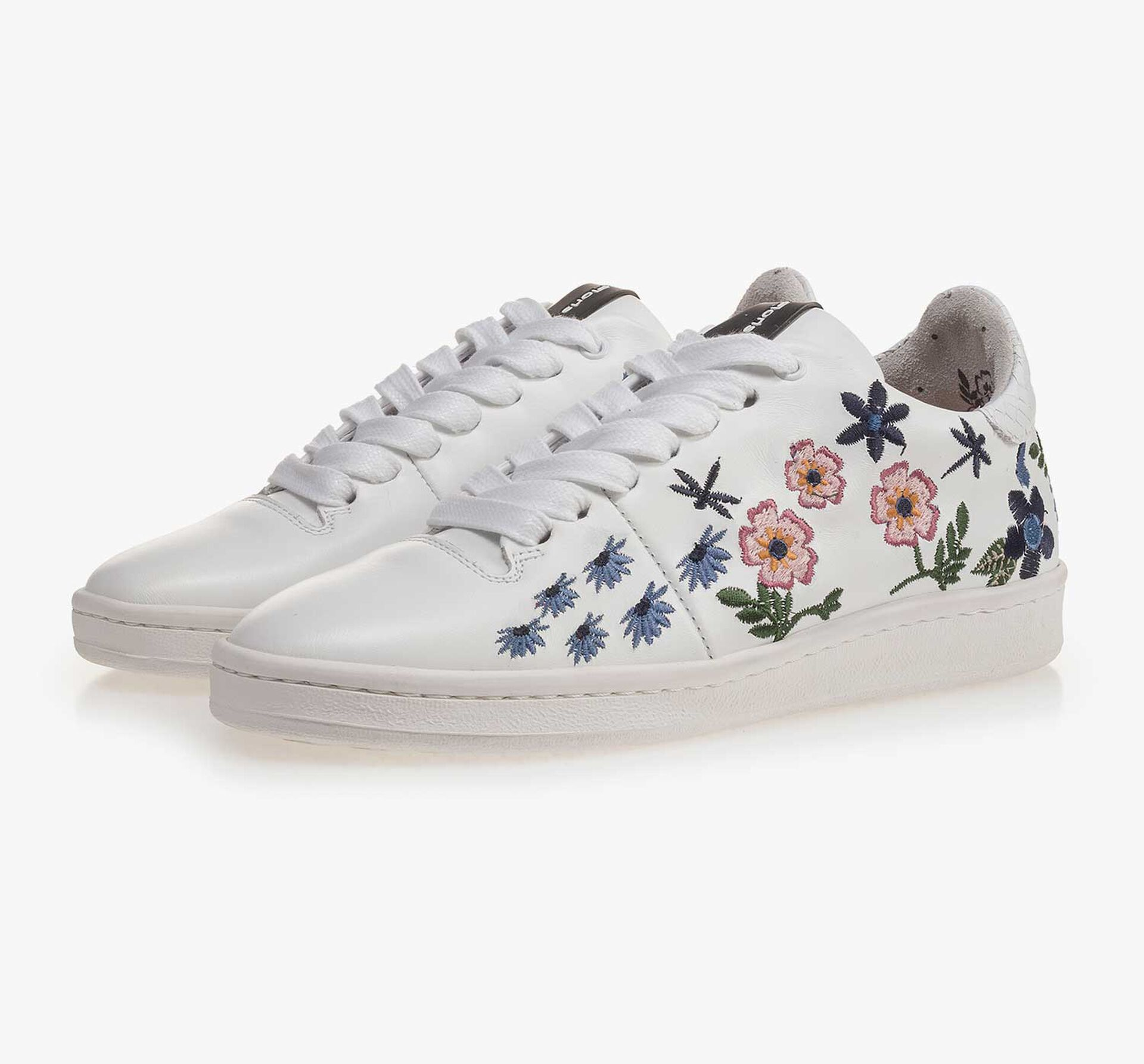 White leather sneaker with floral embroidery stitching