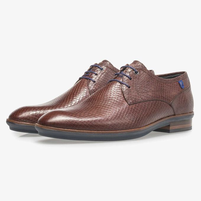 Cognac-coloured leather lace shoe with snake print