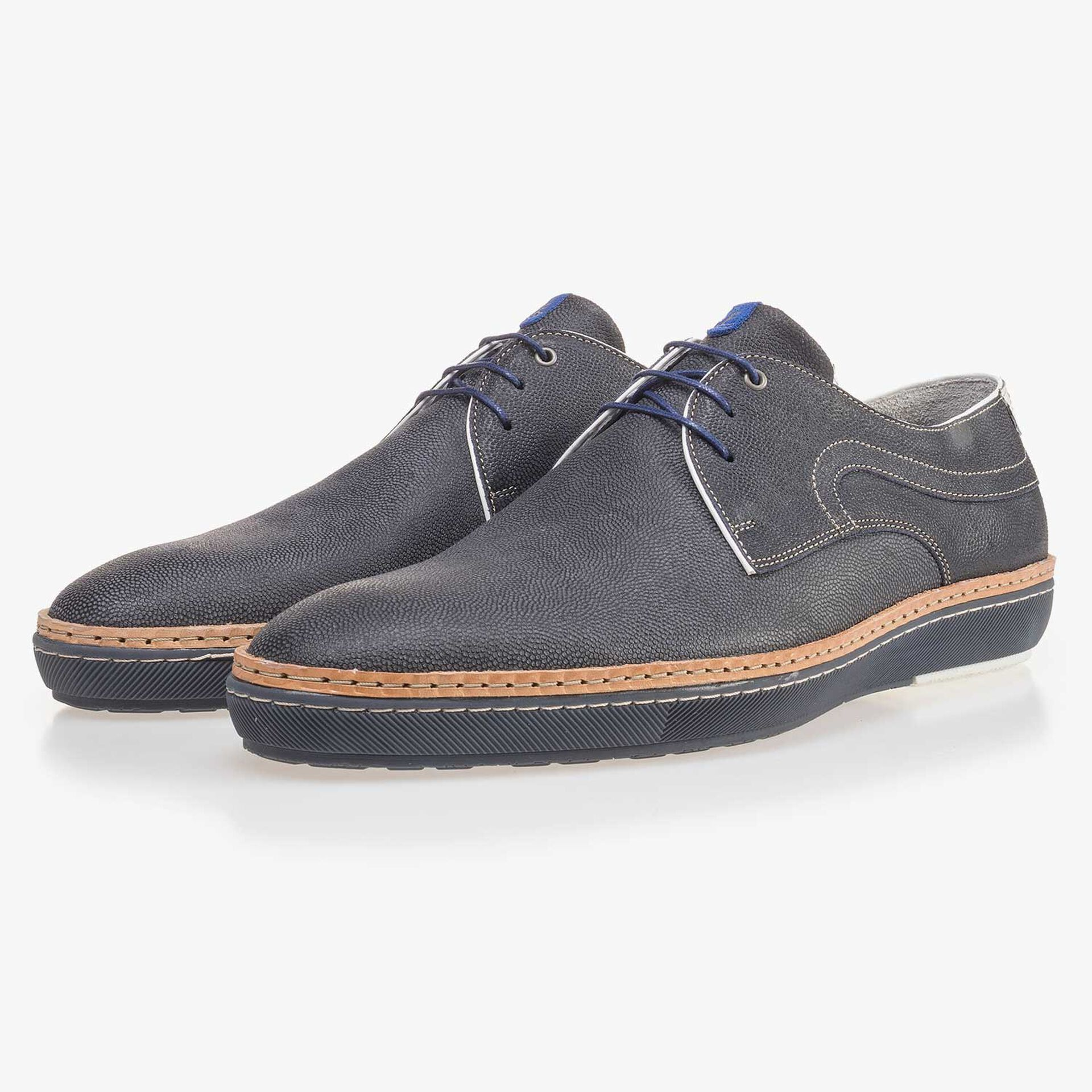 Blue patterned lace shoe made of suede leather