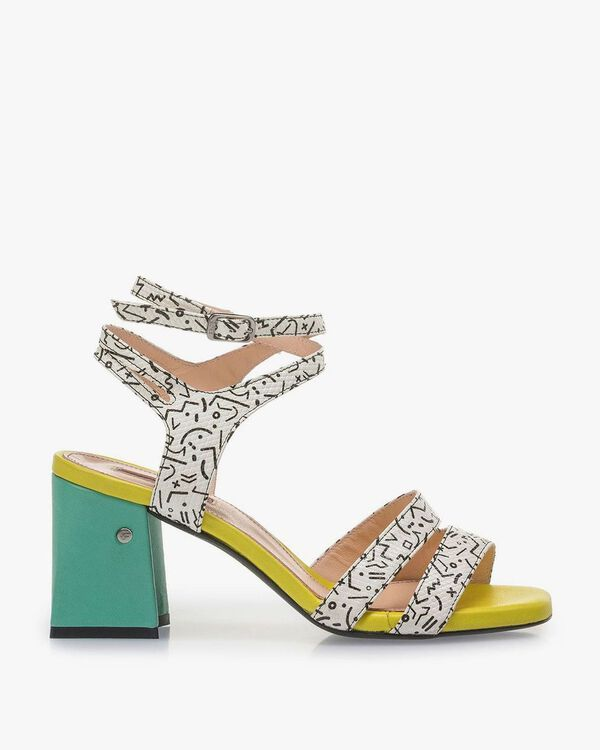 White high-heeled sandals with black print