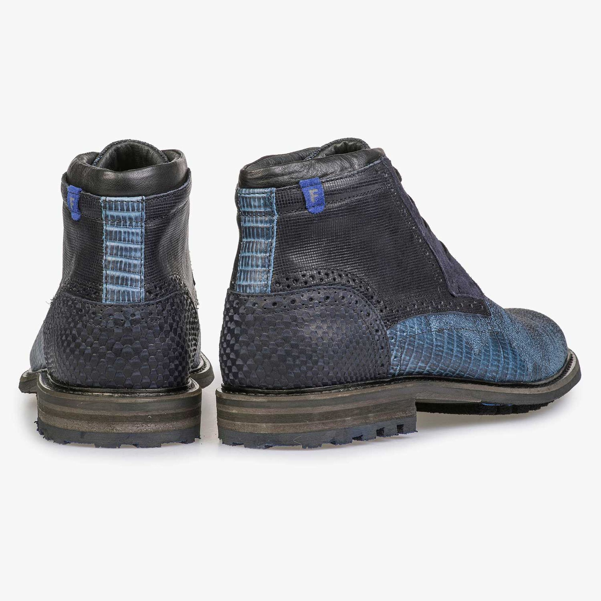Blue leather lace boot with structural pattern